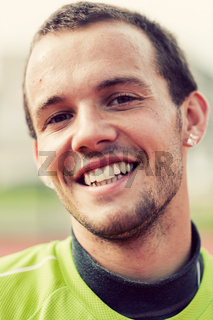 Portrait of a young active man smiling during sport training