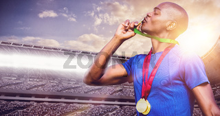 Composite image of profile view of winner kissing medals