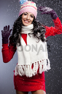 beautiful fashionable woman with snow