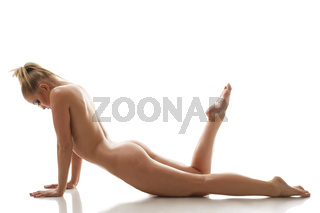 Seductive naked girl lying, isolated on white