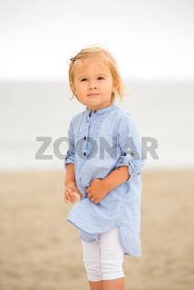 Cute curious little girl at the beach