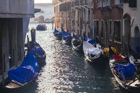 Venetian gondolas in narrow channel