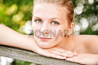 Beautiful woman leans against handrail