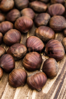 Group of Fresh Chestnuts on Wooden Background