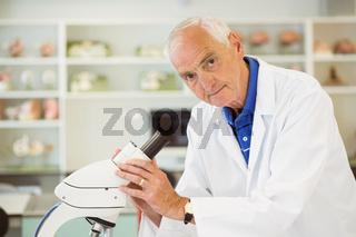 Senior scientist working with microscope