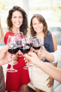 Group of friends having wine