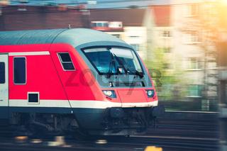 High speed passenger train on tracks in motion