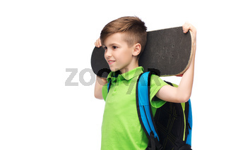 happy student boy with backpack and skateboard