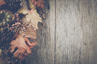 Autumn Leaves on Rustic Wood Background with Instagram Style Filter