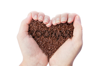 Two hands holding chocolate sprinkles