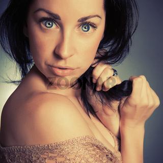 portrait brunette cute girl with blue eyes