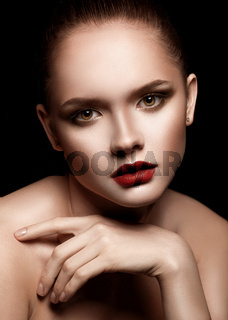 Portrait of Beautiful Young Woman with perfect make-up.