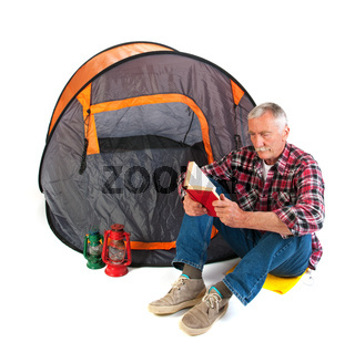 Senior man by tent