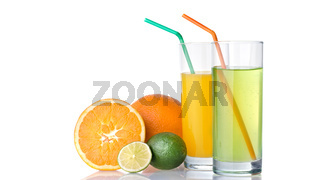 glasses of orange and lime juices with orange and lime fruits