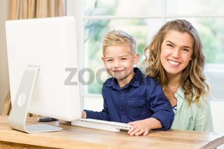 Mother and son using the computer
