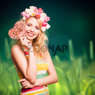 attractive woman with tulip hair decoration and a present