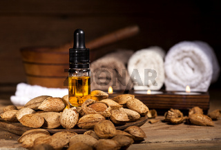 Almond oil on an old wooden background