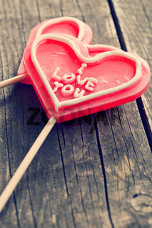 Lollipop heart on vintage wooden background