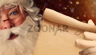 Closeup of Santa Claus holding a Santa List