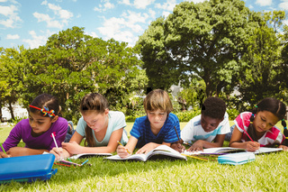 Children doing homework at park