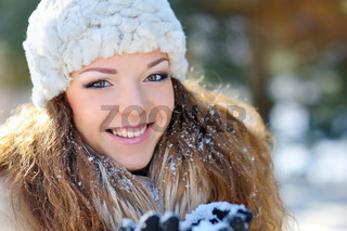 portrait of a beautiful girl on the street in winter