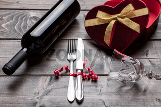 Romantic dinner set on rustic wooden background