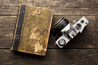 vintage 35mm film camera and old book