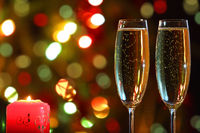 glasses with champagne and candle