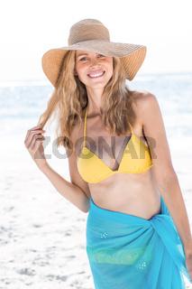 Smiling pretty blonde in bikini looking at camera