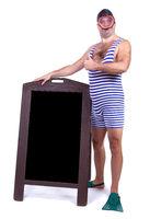 Man in swimsuit standing beside menu