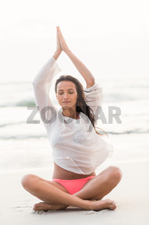 Sporty brunette sitting in lotus pose