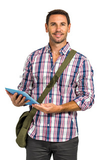 Smiling man with shoulder bag using tablet and looking at the camera