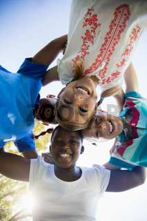 Kids posing together during a sunny day at camera