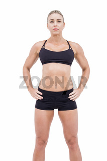 Female athlete posing with hands on hip