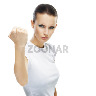 young woman close-up threatens fist into camera