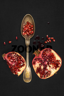Pomegranate isolated on black background, top view.