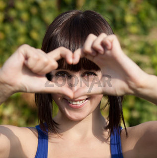 Beautiful girl show love sign