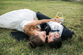Wedding couple lying on the grass