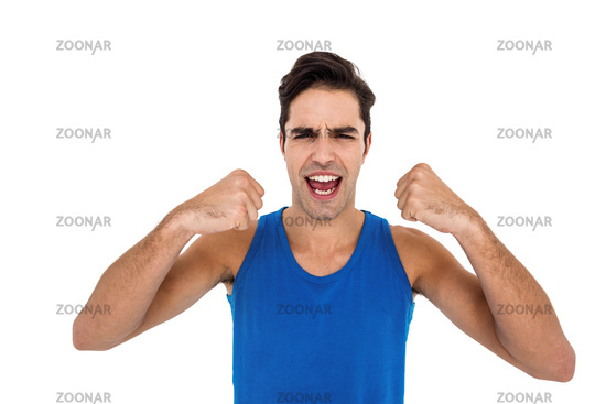Excited male athlete posing after victory