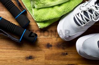 sport concept. dumbbells, shoes and towel