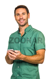 Portrait of smiling man holding smartphone