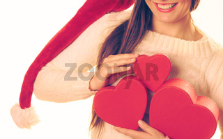 Girl holds heart shaped gift boxes