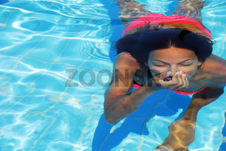 Teenage girl in the swimming pool