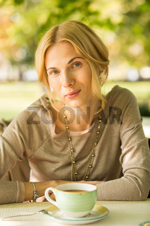 portrait of a beautiful young woman in park.