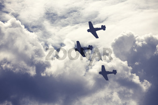 Fighter planes on cloudy sky