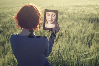 morning portrait of beautiful girl in green field