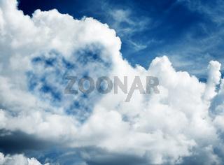 Heart shaped cloud on blue sunny sky. Love