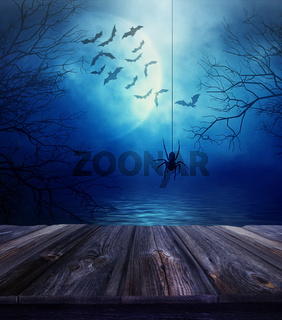 Wooden floor with spider and Halloween background