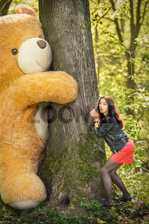 girl plays with teddy bear