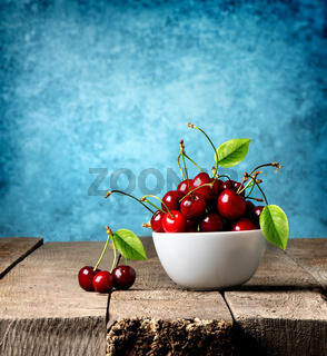 Red cherries in plate